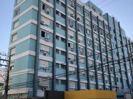 Apartamento 02 dormitórios com dependência e garagem central
