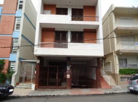 Apartamento 4 dormitórios, dependência e garagem, centro