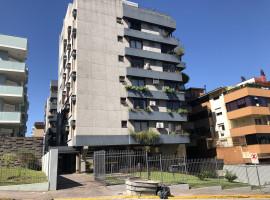 Apartamento 02 domitórios, central com garagem